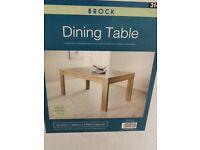 Brand new contemporary light oak dining table still in box
