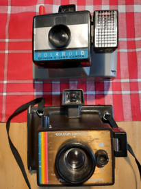 Two vintage collectible Polaroid cameras