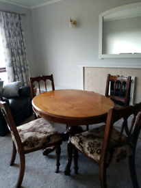Edwardian table and 4 chairs.