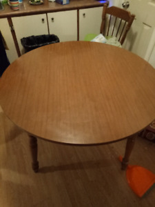 Reduced Price .Round dining table with 4 chairs. Urgent.