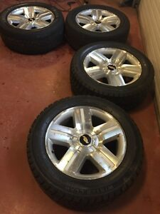 4 Chev rims with tires