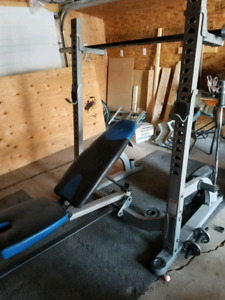 Nautilus Squat/Bench rack with olympic bar and rogue plate