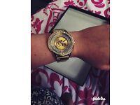 Gold micheal kors watch.