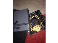 2 items of dress jewellery bracelets/bangles.