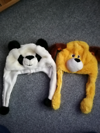 2 ANIMAL HATS. A DOG WITH MOVEABLE EAR AND A PANDA.