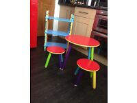 Chdren's round colourful table with stools and book shelf