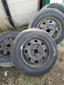 Set of 4 tires on rims. Size 155 80 13