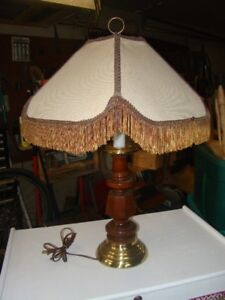 Old wood table lamp with tassel shade