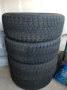 4 BRIDGESTONE BLIZZAK WINTER Tires 275/60/20