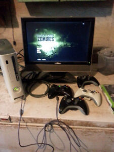 2 XBox 360 consoles with controllers and games