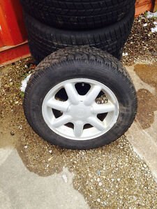 4 snow tires and rims Volkswagen golf