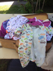 Baby and toddler clothing and items for sale.