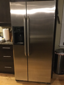 GE side by side refrigerator with water and ice dispenser