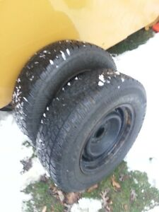 two 215/70R15 Snow Tires, Artic Claw, on ford rims, 7/32-8/32 tr
