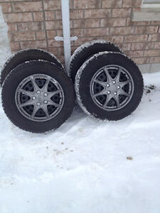 SNOW TIRES P205/65/R15 ON RIMS SET OF 4 $450.00 (NPLN09121)