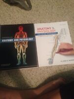 Anatomy and physiology textbook and the colouring book.
