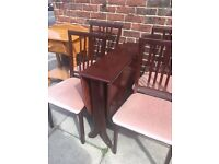 Heavy solid drop leaf table and four chairs