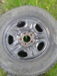 """Set of 4-225/70""""studded winter tires on rims"""