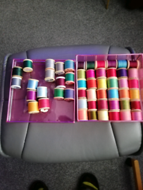 53 ASSORTED COLOURS OF COTTONS IN BOX.