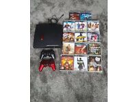 PS3 with 2 controls and 14 games - bargain