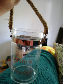 For sale a lovely glass jar for candles to have out side or in doors