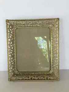 Ornate brass/metal frame with wide filigree sides