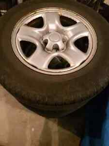 Set of 4 215/70R16 Toyo all season tires on rav 4 wheels
