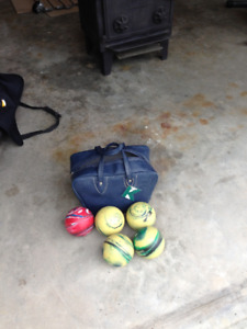 2 sets of bowling balls and bag