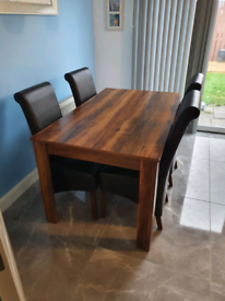 SOLD Walnut wood dining table 4 black leather chairs £50