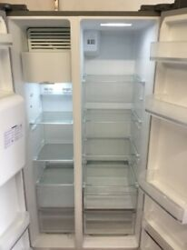 Hotpoint brand new American style fridge freezer ice and water dispenser a few marks