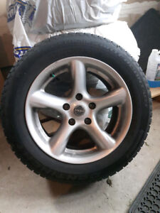 SET OF 4 WINTER TIRES ON RIMS FOR SALE. BRAND NEW CONDITION.