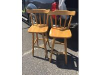 Matching pair of wooden kitchen bar stools