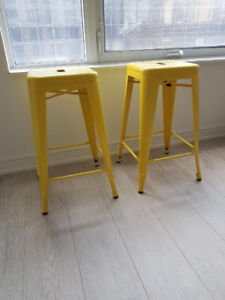 2 yellow tolix style counter height bar stools