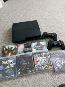 PlayStation 3 with 2 controllers + Games