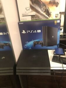 PS4 pro 1TB with 14 games + 2 controllers +  headset ps4 gold