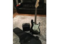 Fender Starcaster Electric Guitar with amp and carry bag