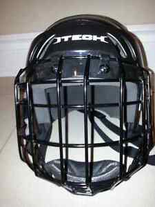 Brand new hockey helmet for boy with face guard