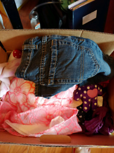 2 boxes and large garbage bag full of baby clothes
