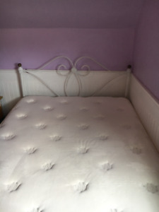 Antique 3/4 Bed with new mattress for sale.