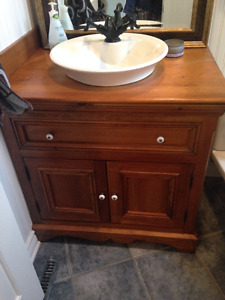 Bathroom Sink, Faucet and Wooden cabinet