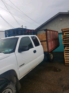 Chevy 3500 4 X4 with flat Deck with removable 4 ft sides