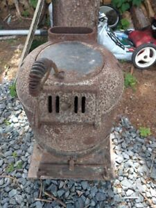 Old cast iron cottage stove. Rare, water heating ability