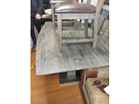 63. Solid grey wood table and chairs