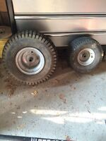 Large and small lawn tractor tires.. only one of each