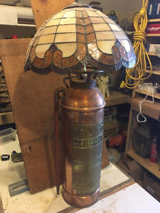Tiffany lamp mounted on antique fire extinguisher