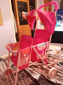 Double buggy, bouncer, carrier, changing bag and lots more