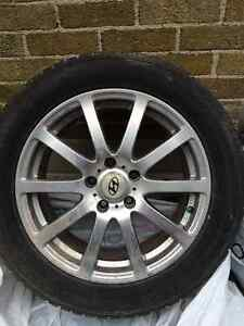 "Winter tires on 17"" aluminum OE Hyundai rims in great condition"