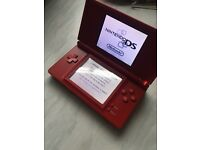 Red Nintendo DS with R4 card