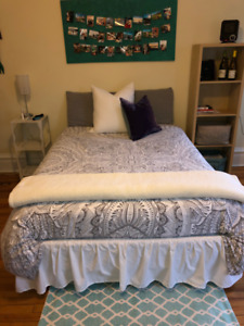 Double mattress, box spring and rails with wheels.