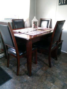 Table with leaf 6 chairs $500